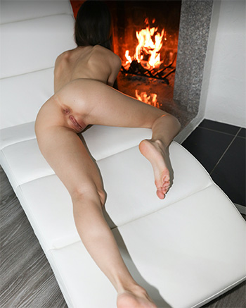 Leona naked in front of fireplace
